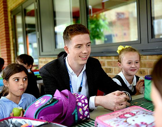 Mr Webster and pupils at lunch break