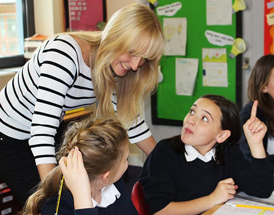 Miss Harris helping pupils