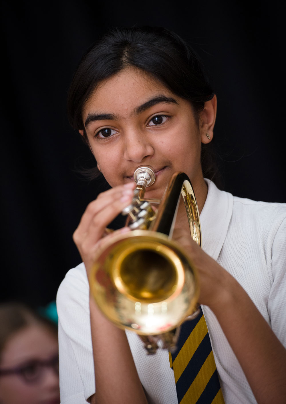 Girl playing the trumpet