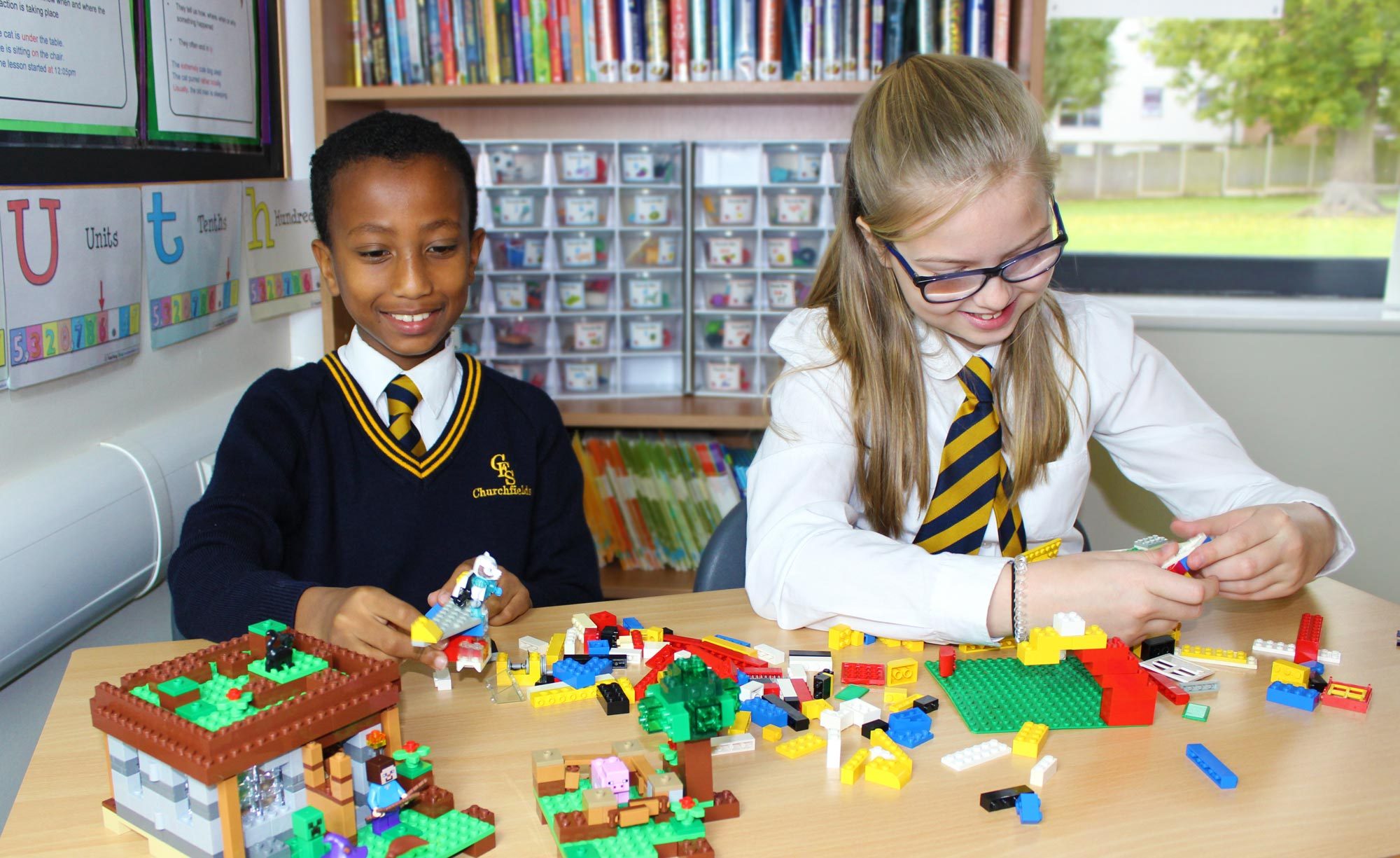 Pupils playing with lego at the Breakfast Club