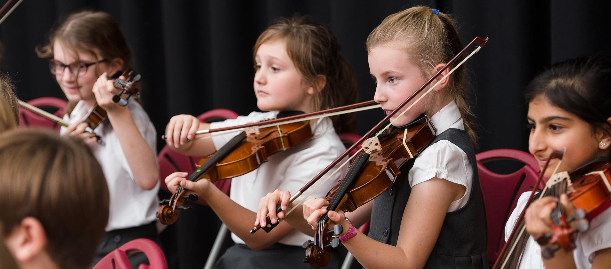 Girls playing the violin