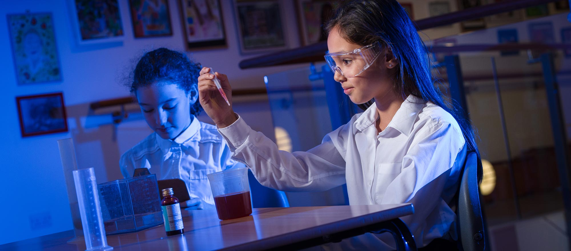 Girl examining the result of a chemistry experiment