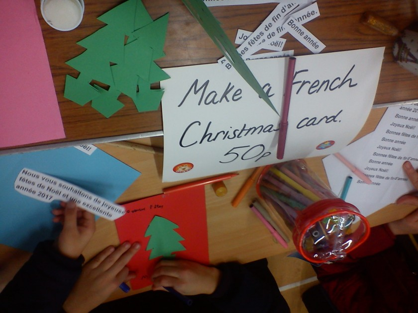 Children making French Christmas cards