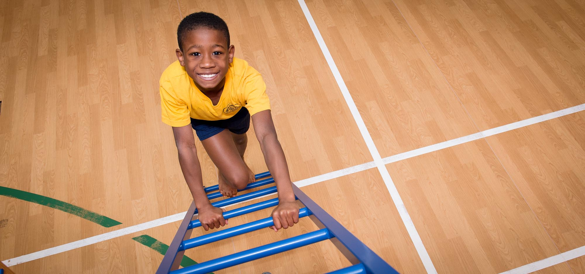 Boy climbing blue ladder