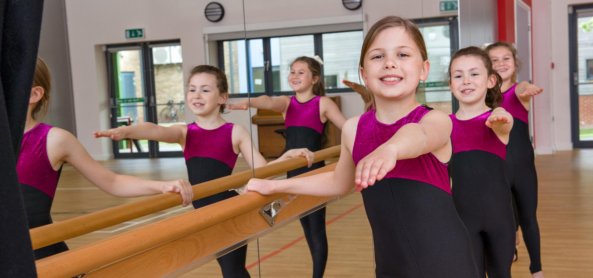 Girls performing ballet exercise