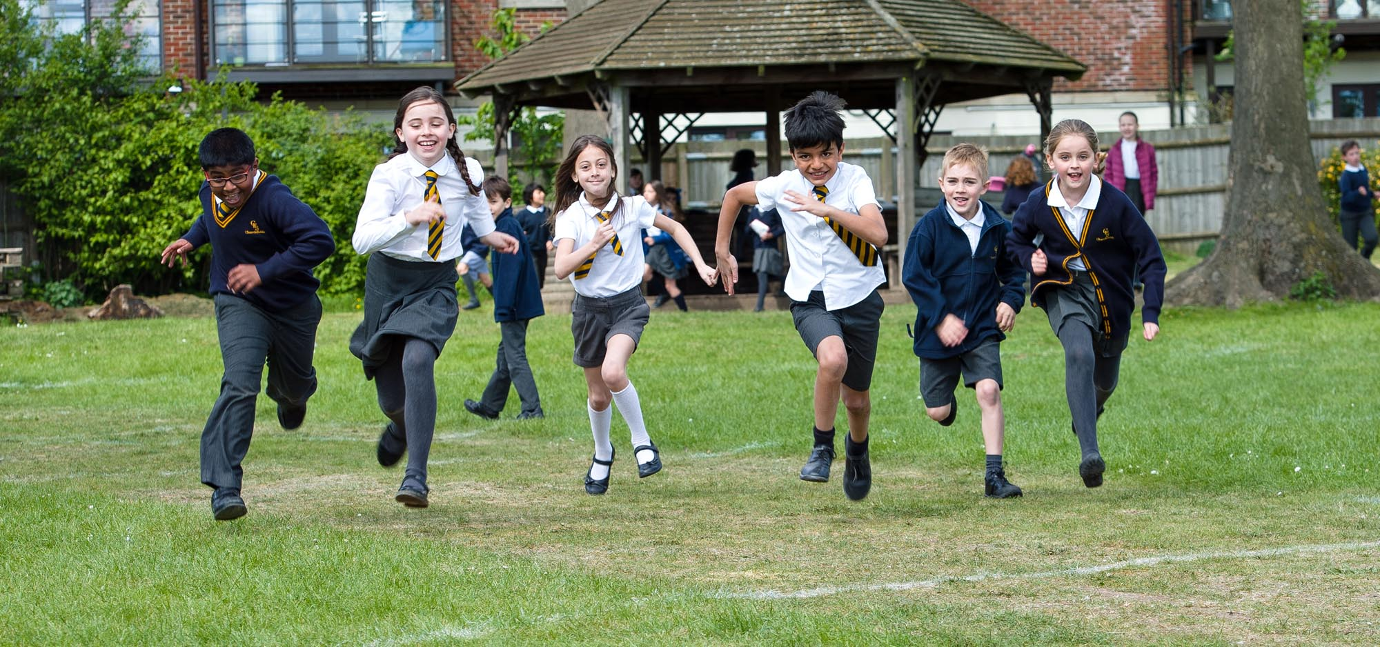 Children in uniform running