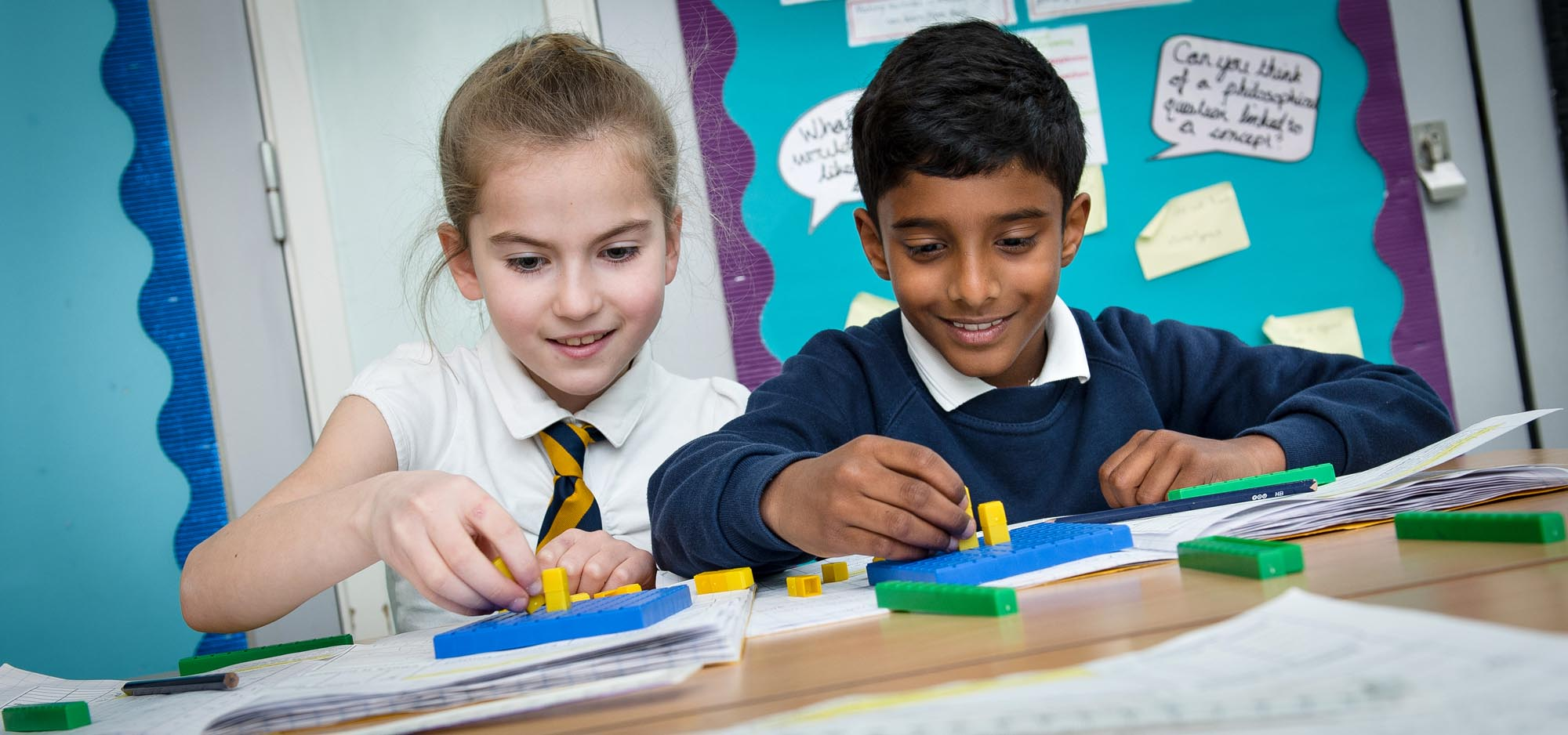 Boy and girl learning with Lego bricks