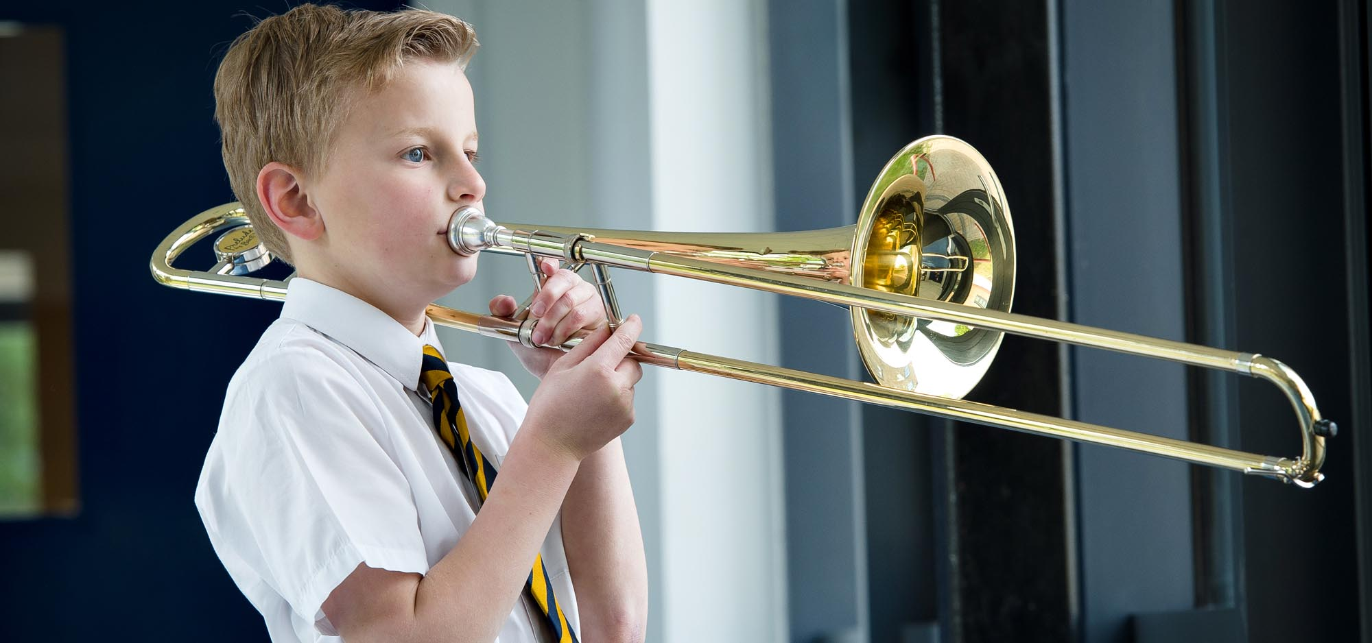 Boy playing the trombone