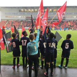 Flag bearers at stadium