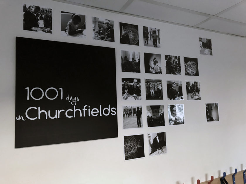 Wall with black and white photos showing 1001 days in Churchfields