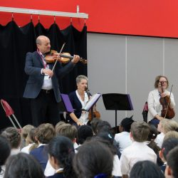 String trio playing on stage