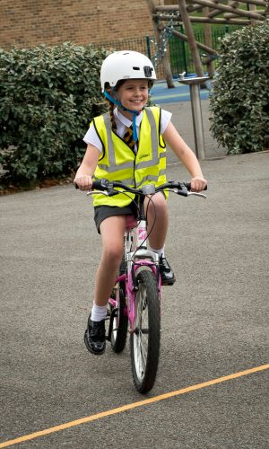 girl cycling on her own