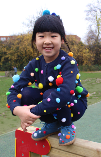 Girl with fun colourful outfit