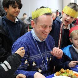 Mr Wilkins and children enjoying Christmas Dinner