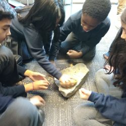 Children taking part in Stone Age activity