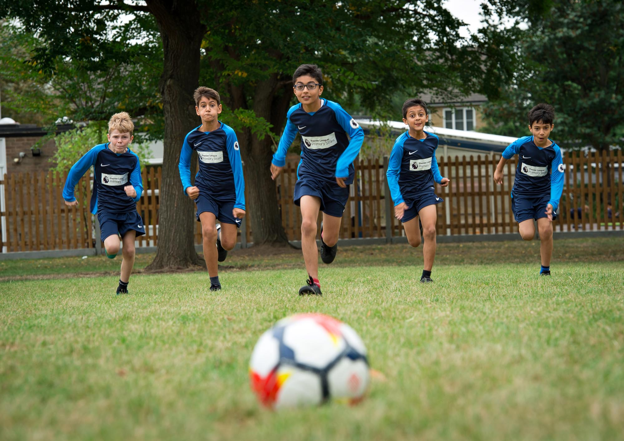 Football team running towards the ball