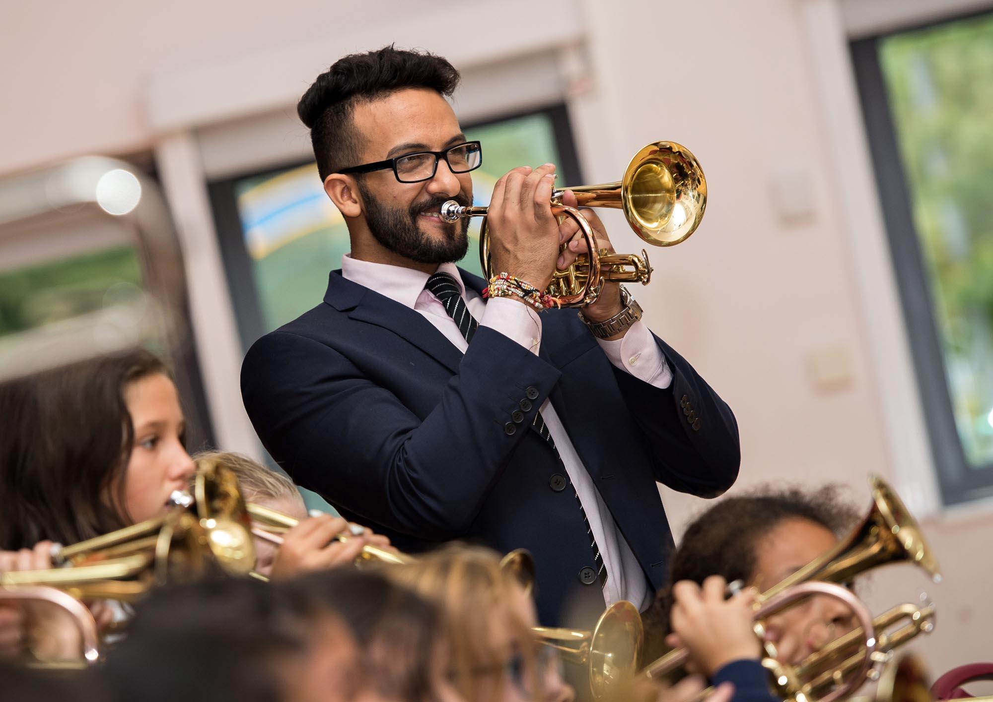 Mr Bali playing the cornet