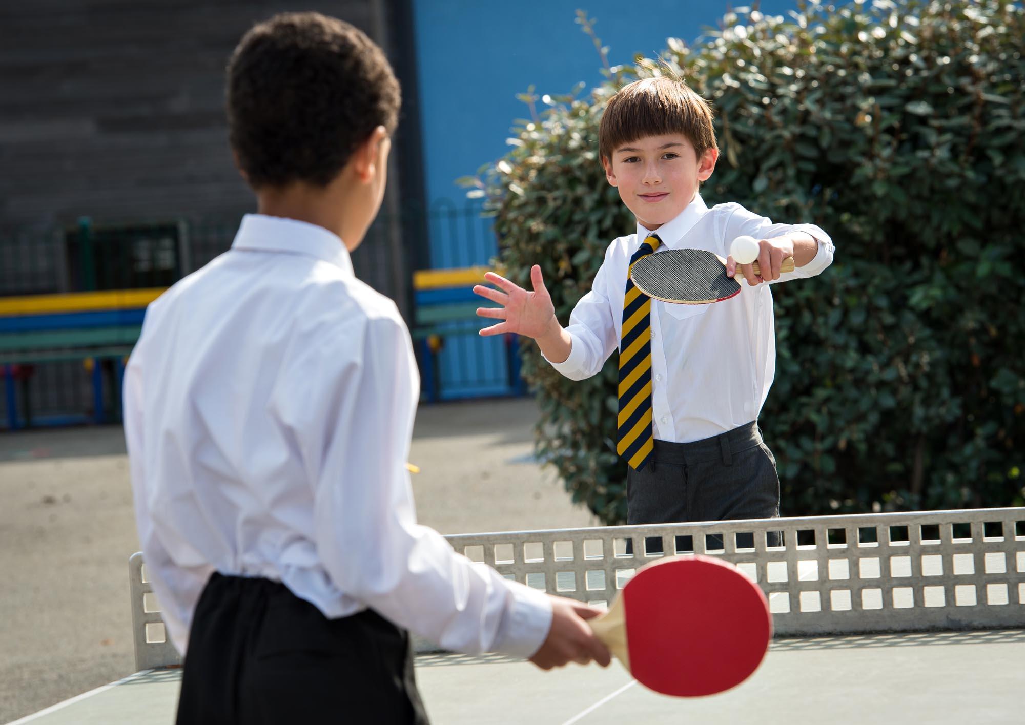 Boys playing table tennis