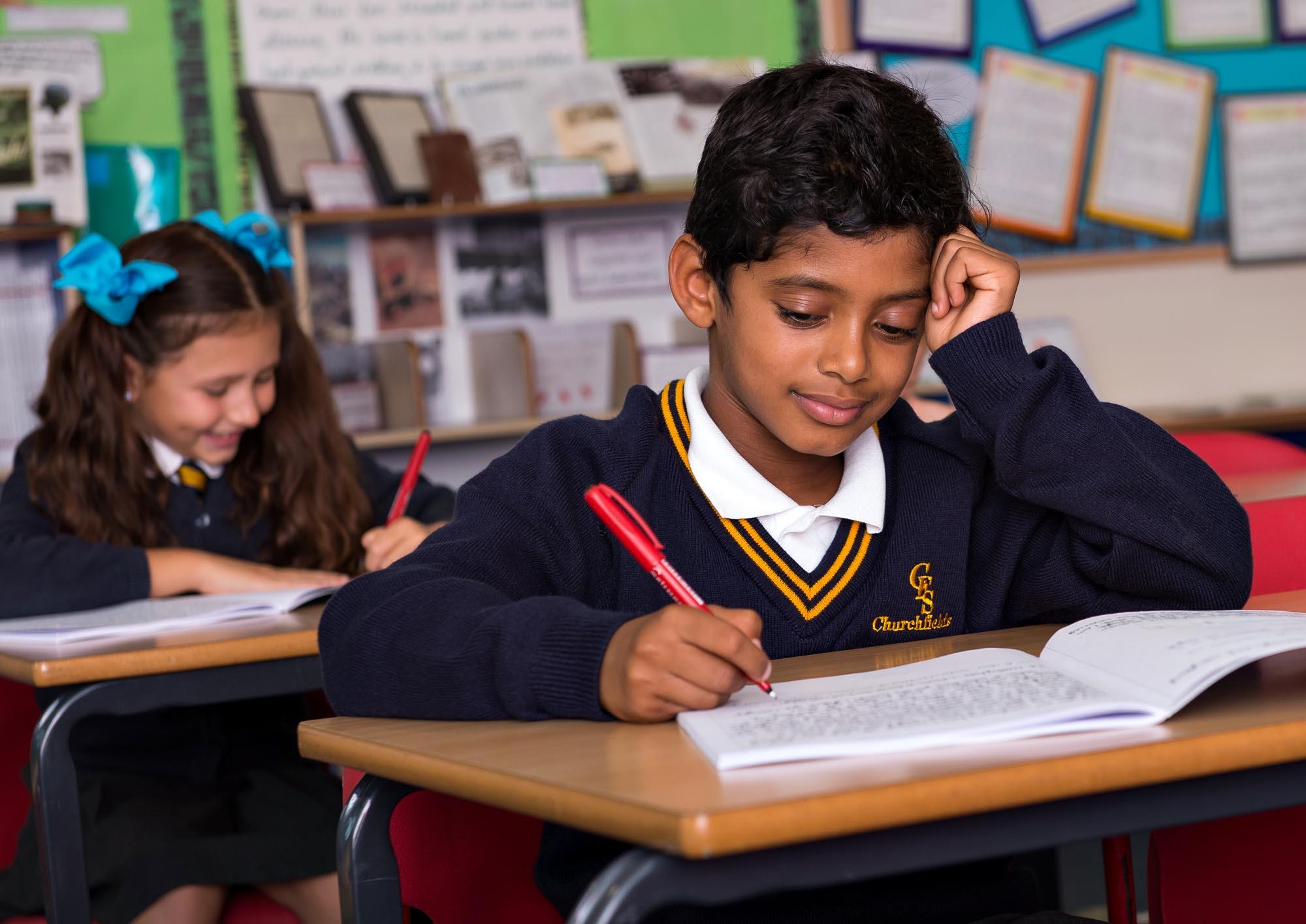 Boy thinking and writing
