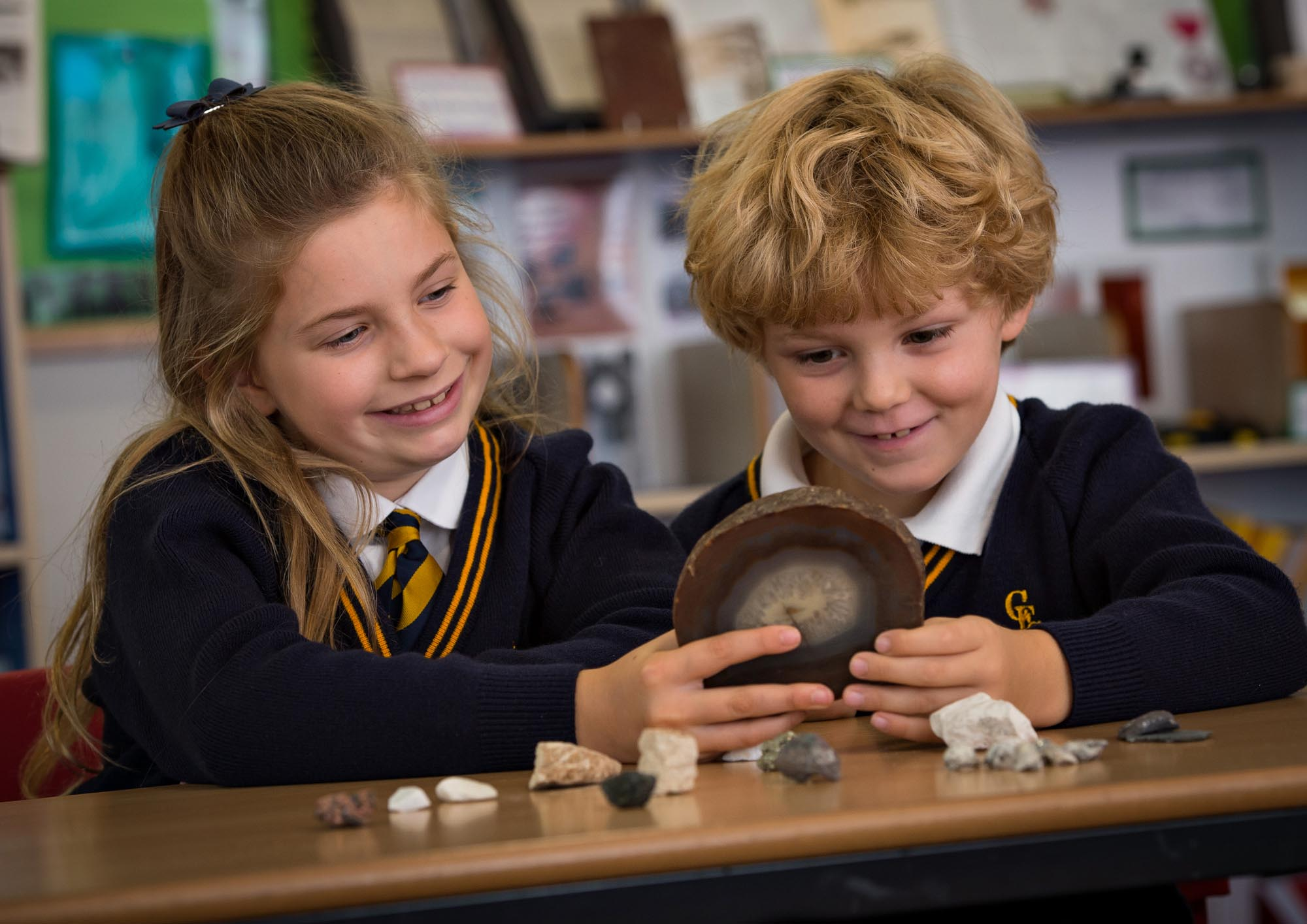 Girl and boy looking at fossils