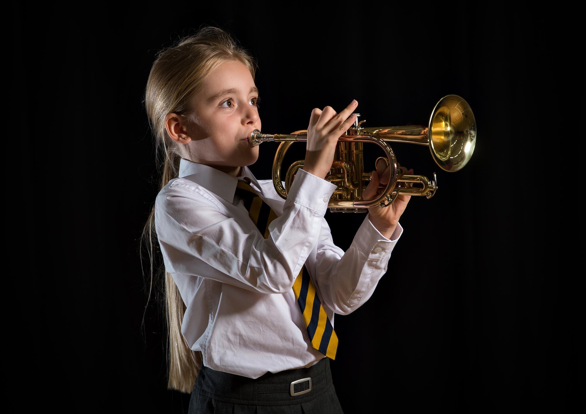 Girl playing cornet