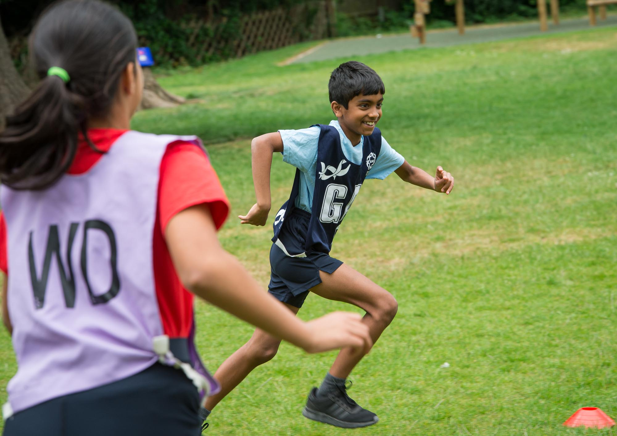 Boy taking part in running game
