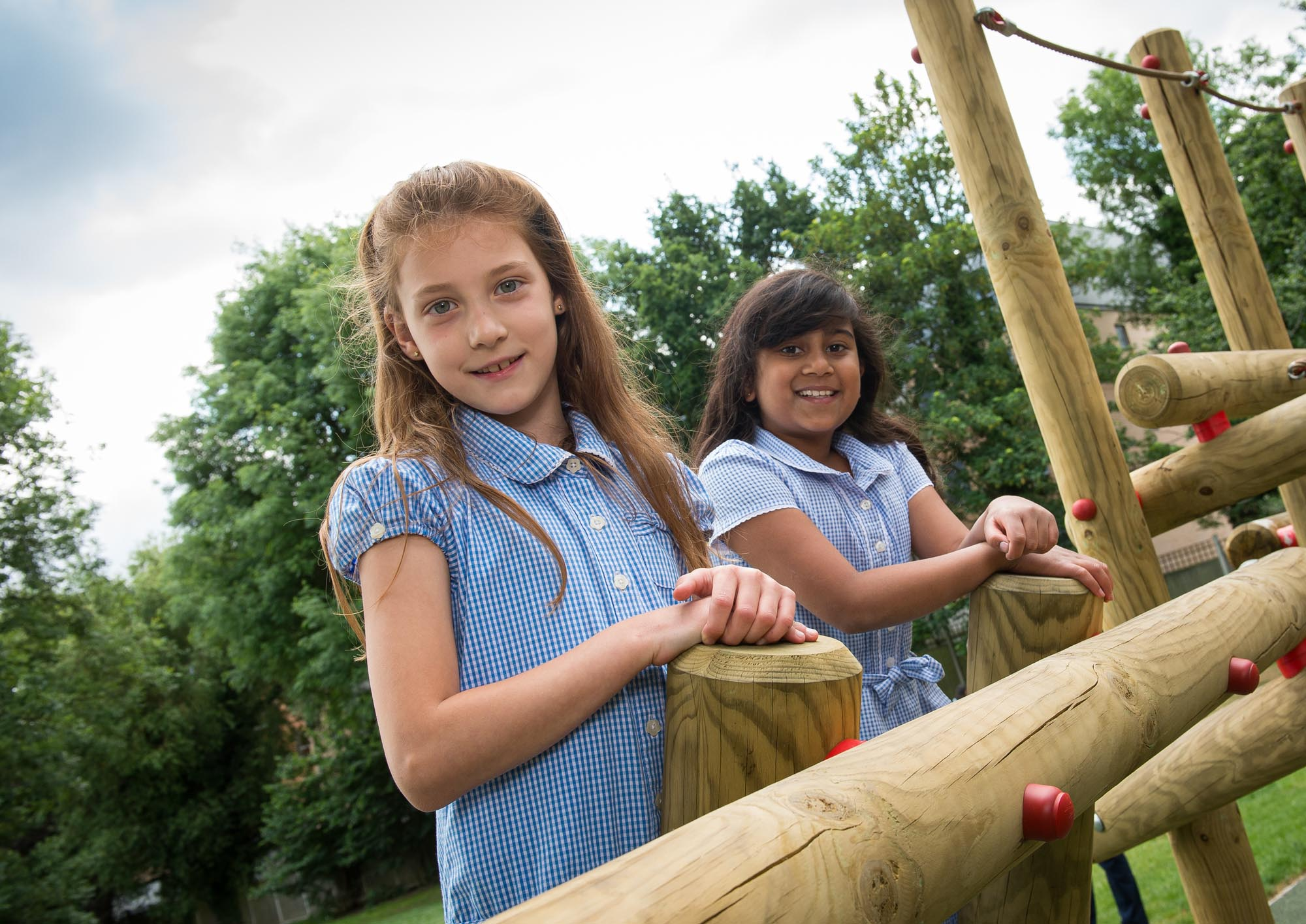 Two girls on climbing frame