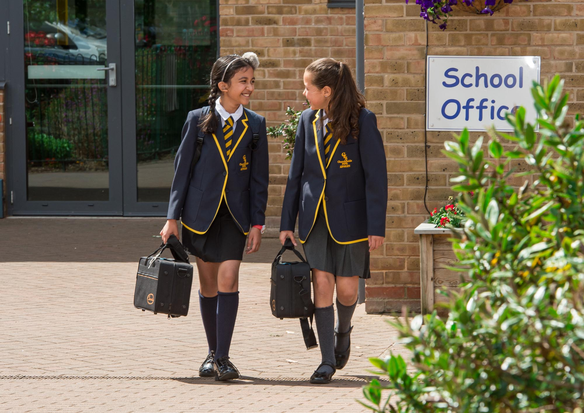 Two girls walking out of school