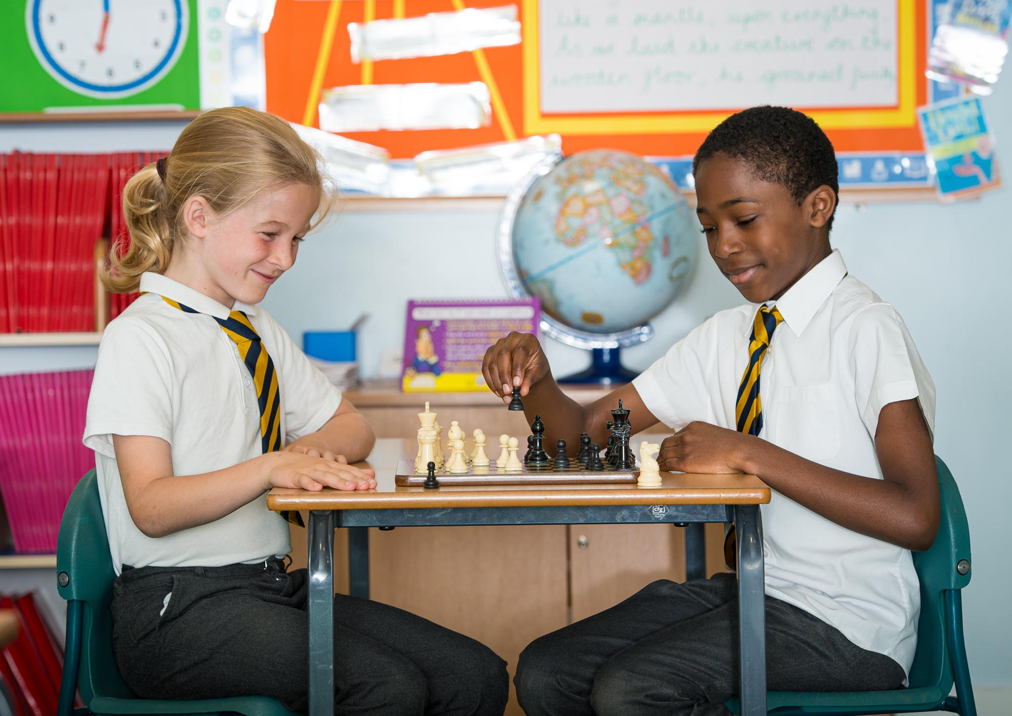Girl and boy playing chess