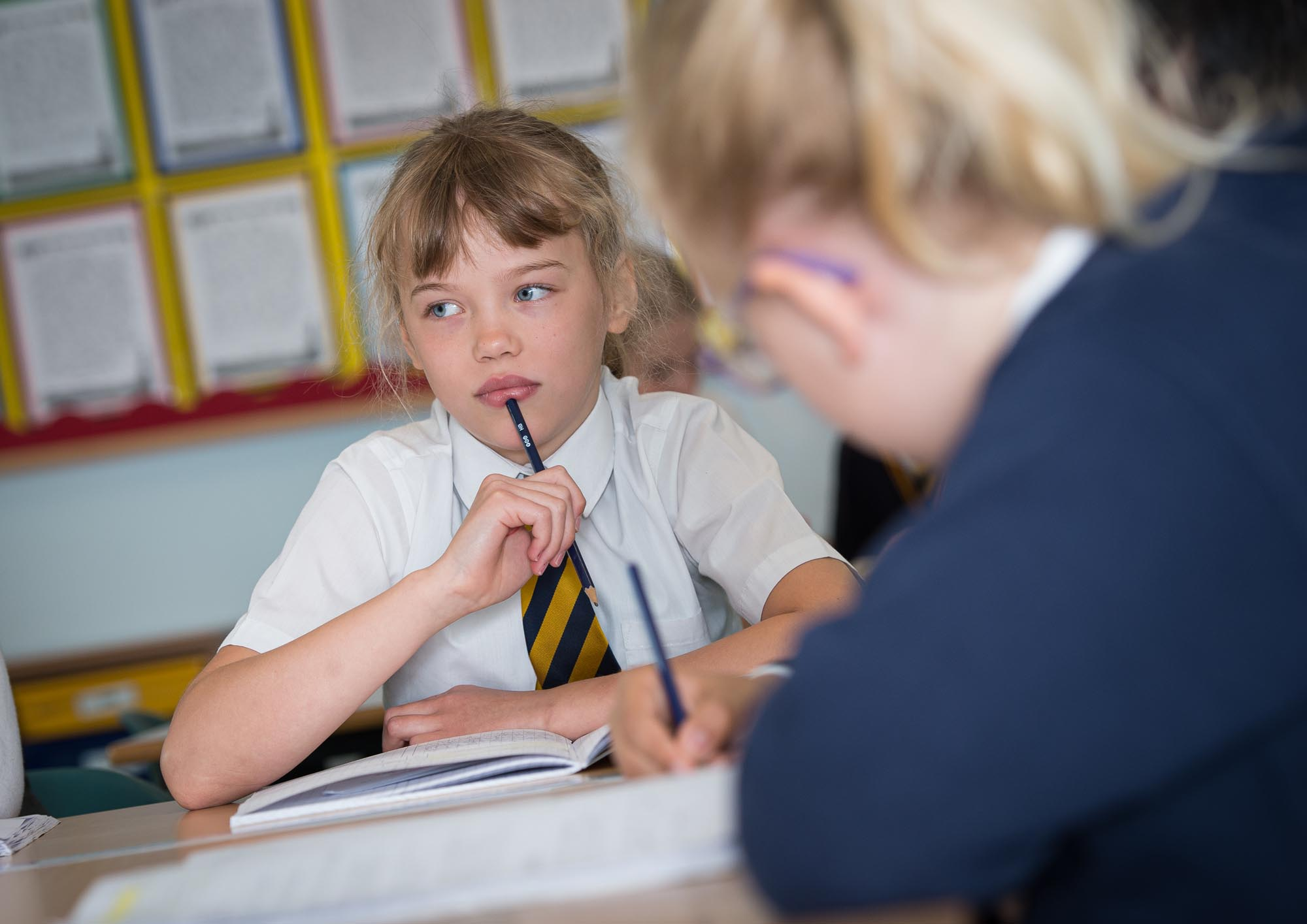 Girl at desk being thoughtful