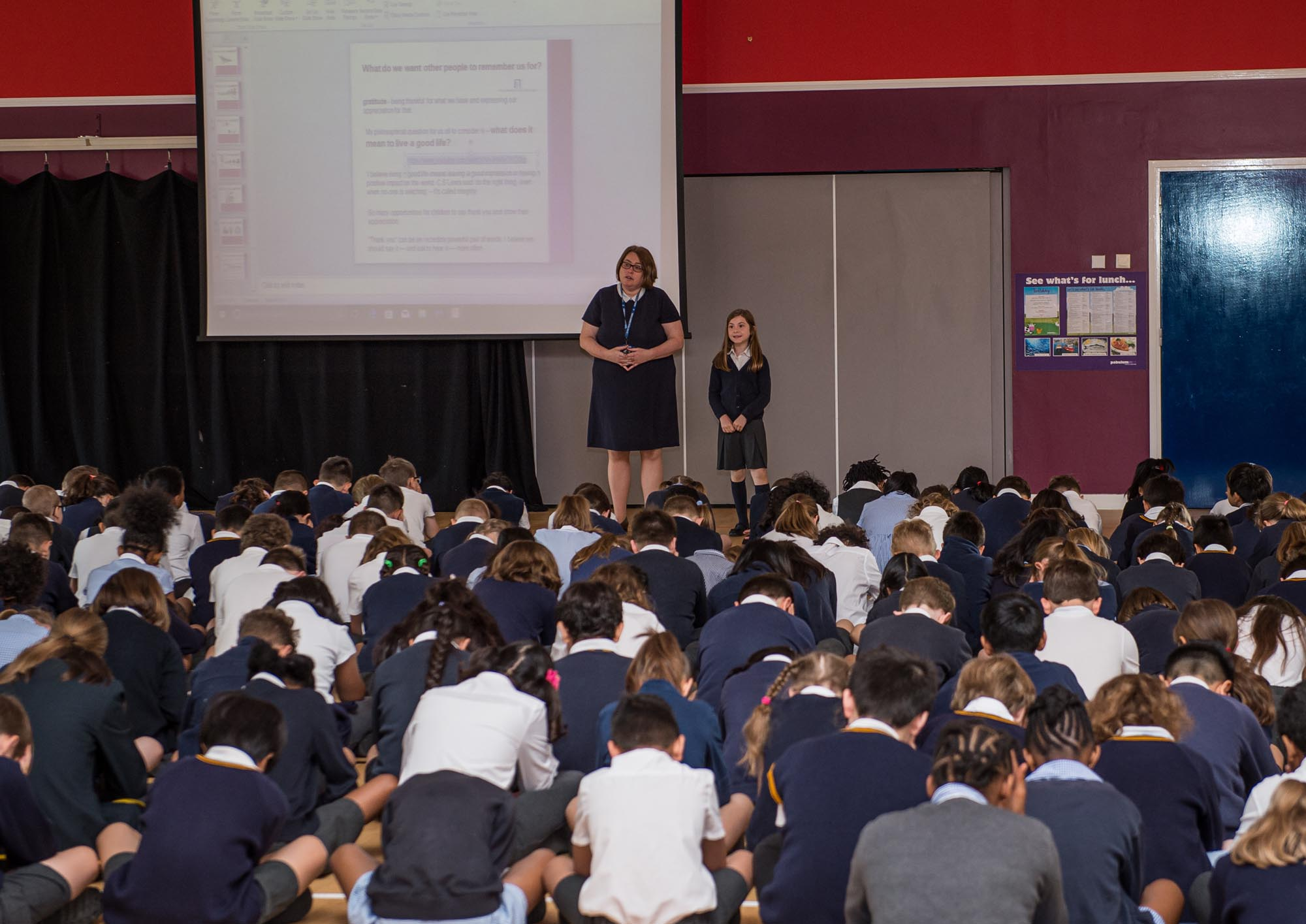 Mrs Emeny leading assembly in the hall