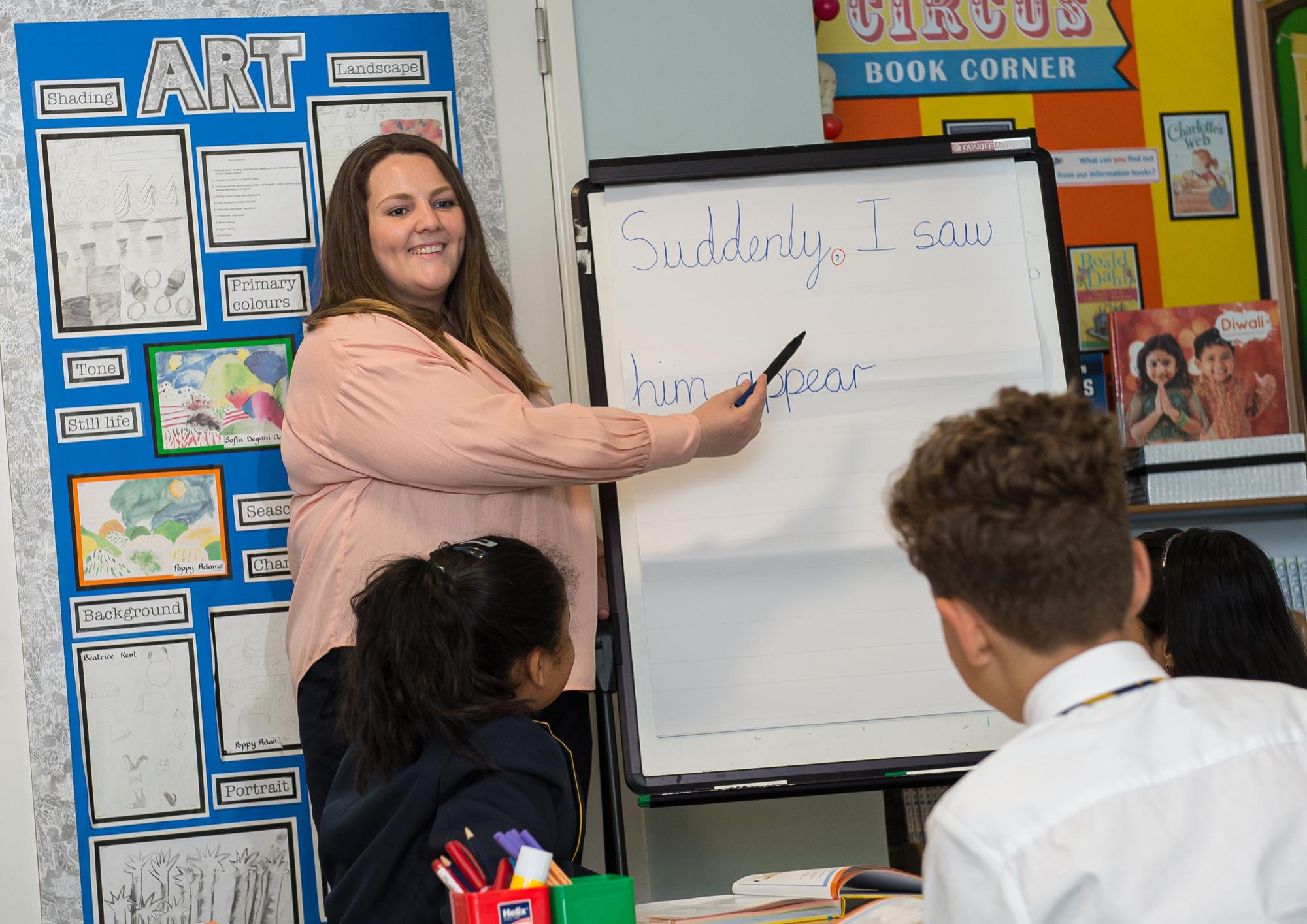 Teacher pointing at words on flipchart