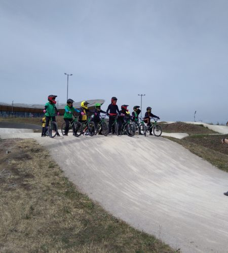 Children lined up with BMX bicycles