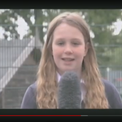 Girl holding microphone in news report