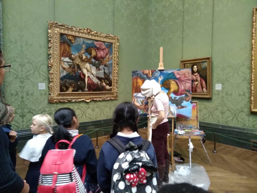 Children in front of woman painting in the National Gallery