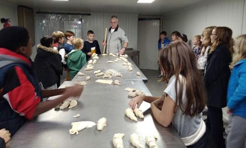 Children making croissants