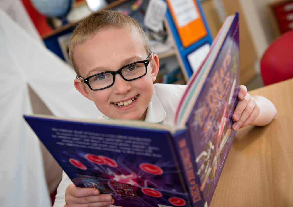 boy reading science book