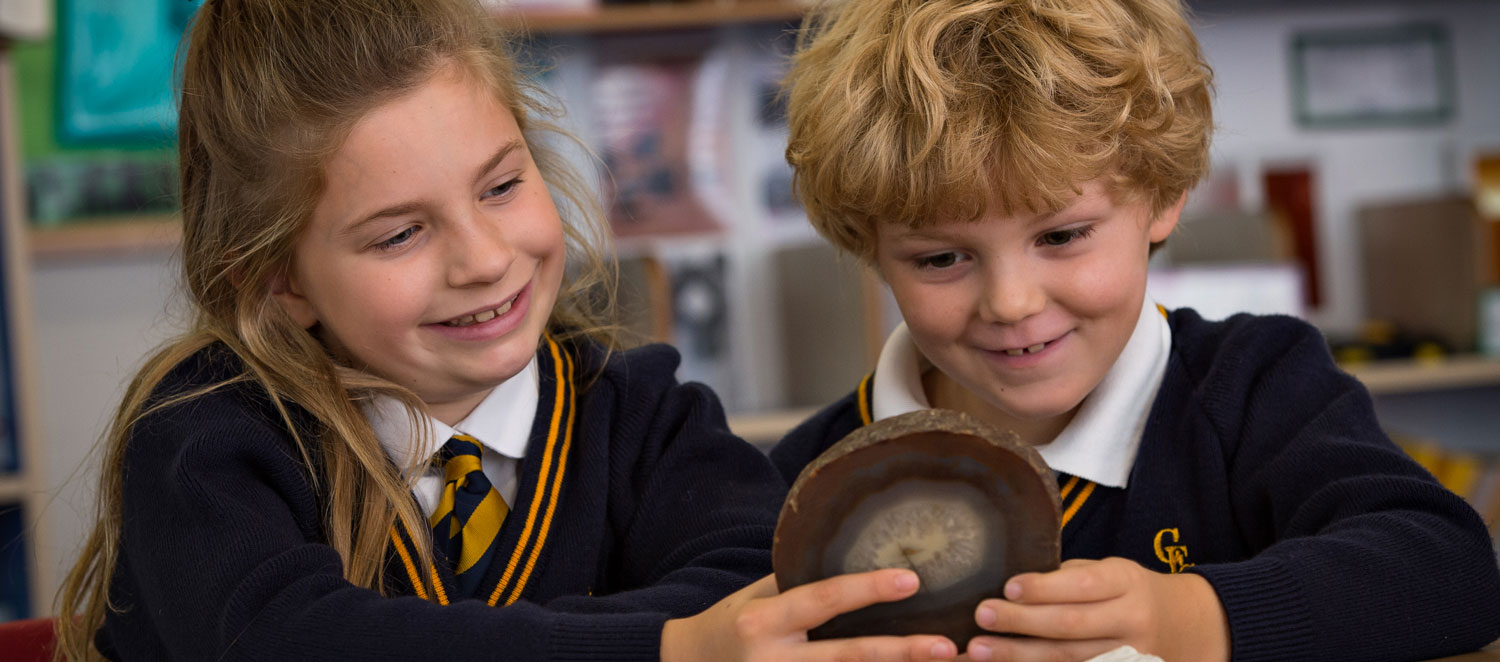 Boy and girl looking at fossils