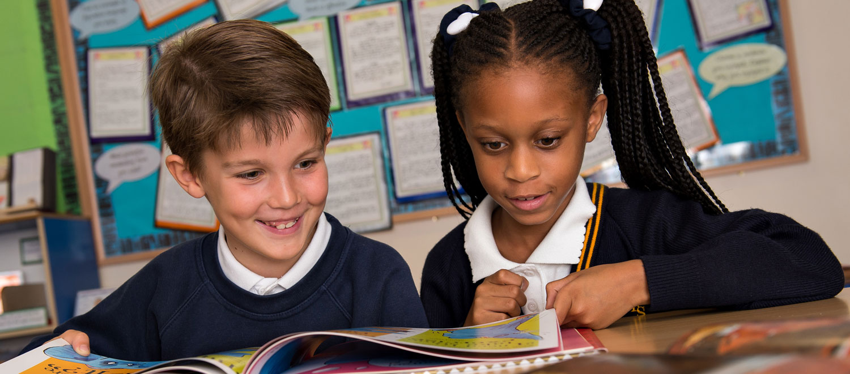 Pair of children reading