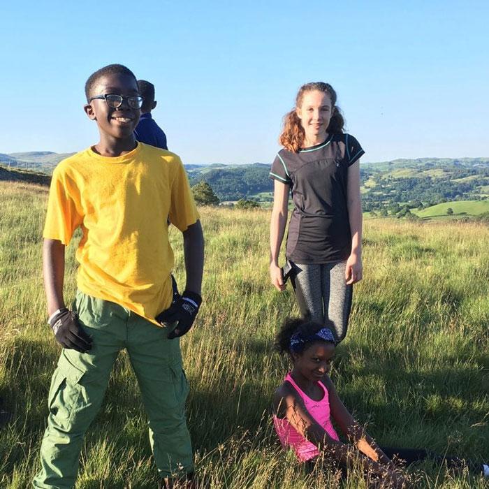 Children on top of a hill in Rhos y Gwaliau on a sunny day
