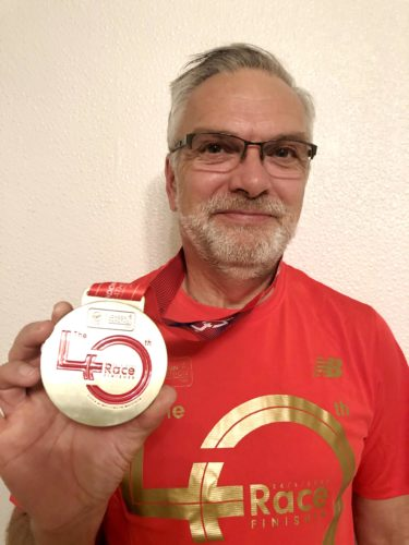 Mr Coleman holding his medal