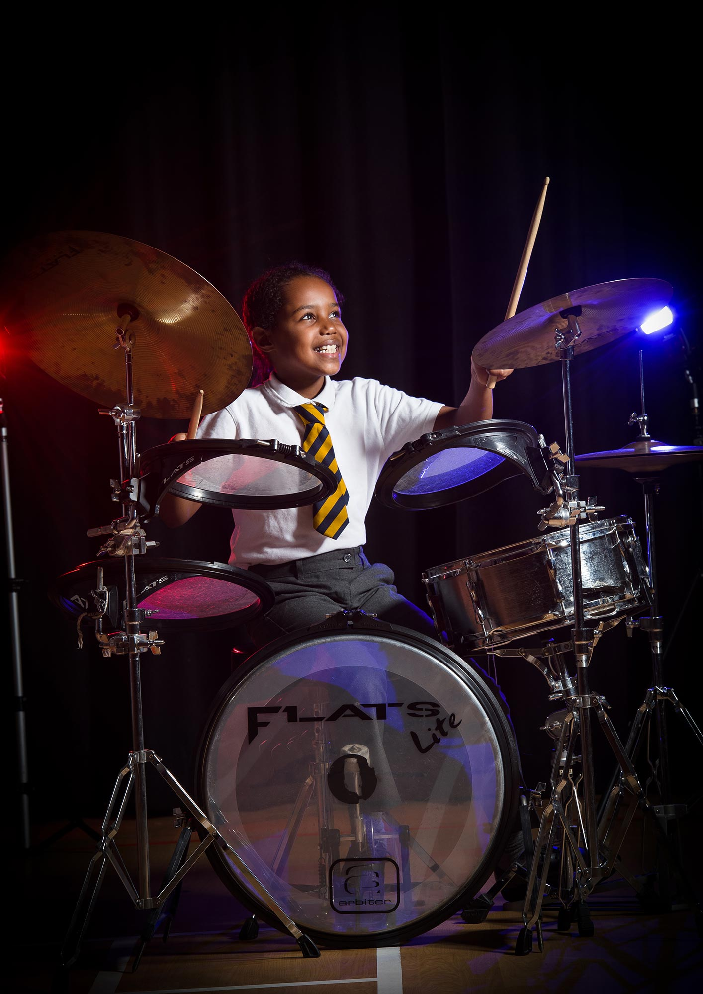 Girl playing the drums