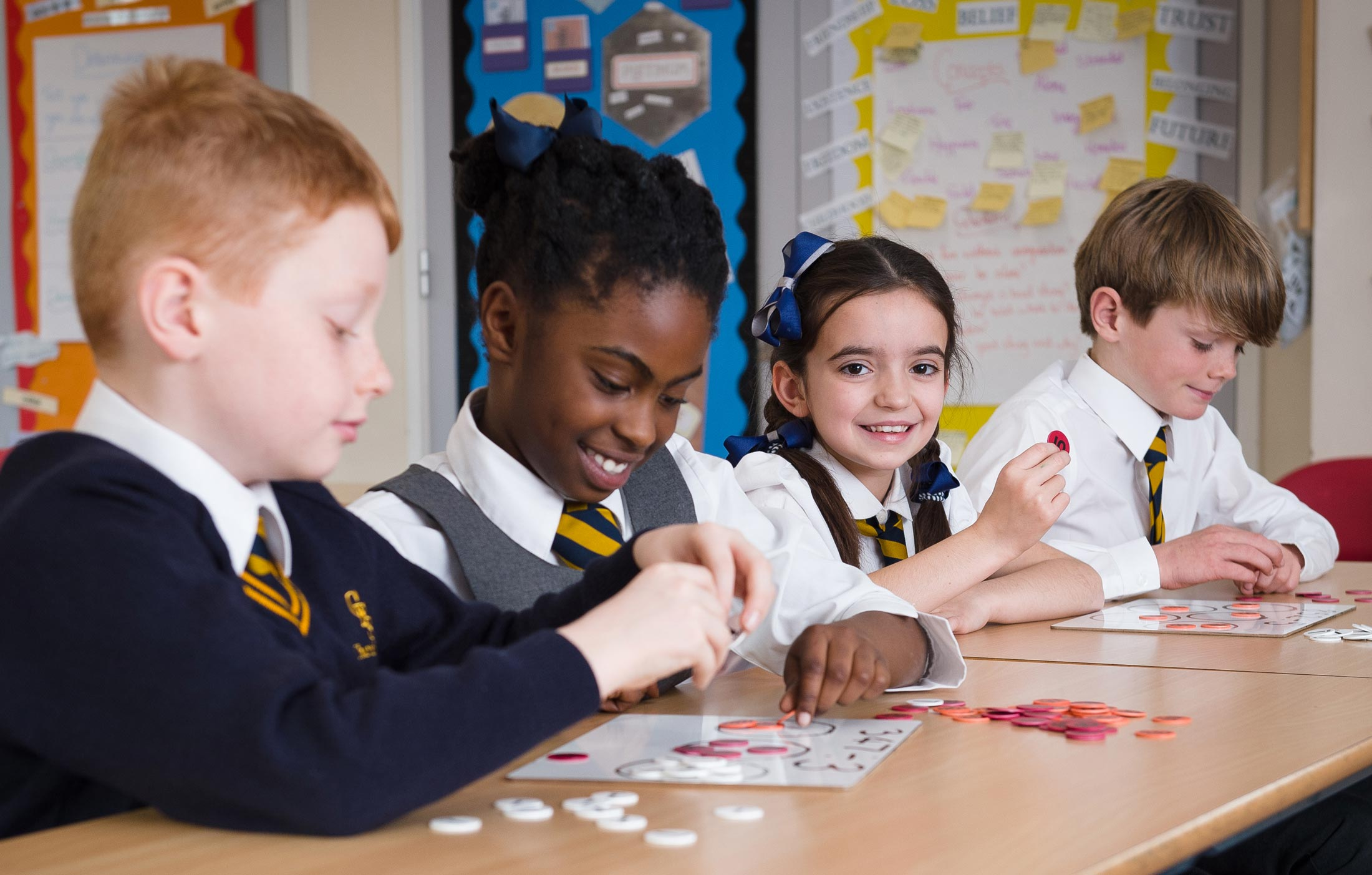 Four pupils using markers to learn maths