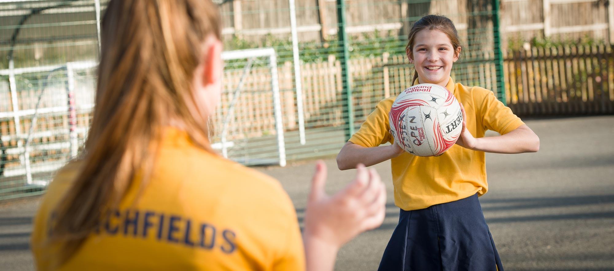 Girl throwing ball