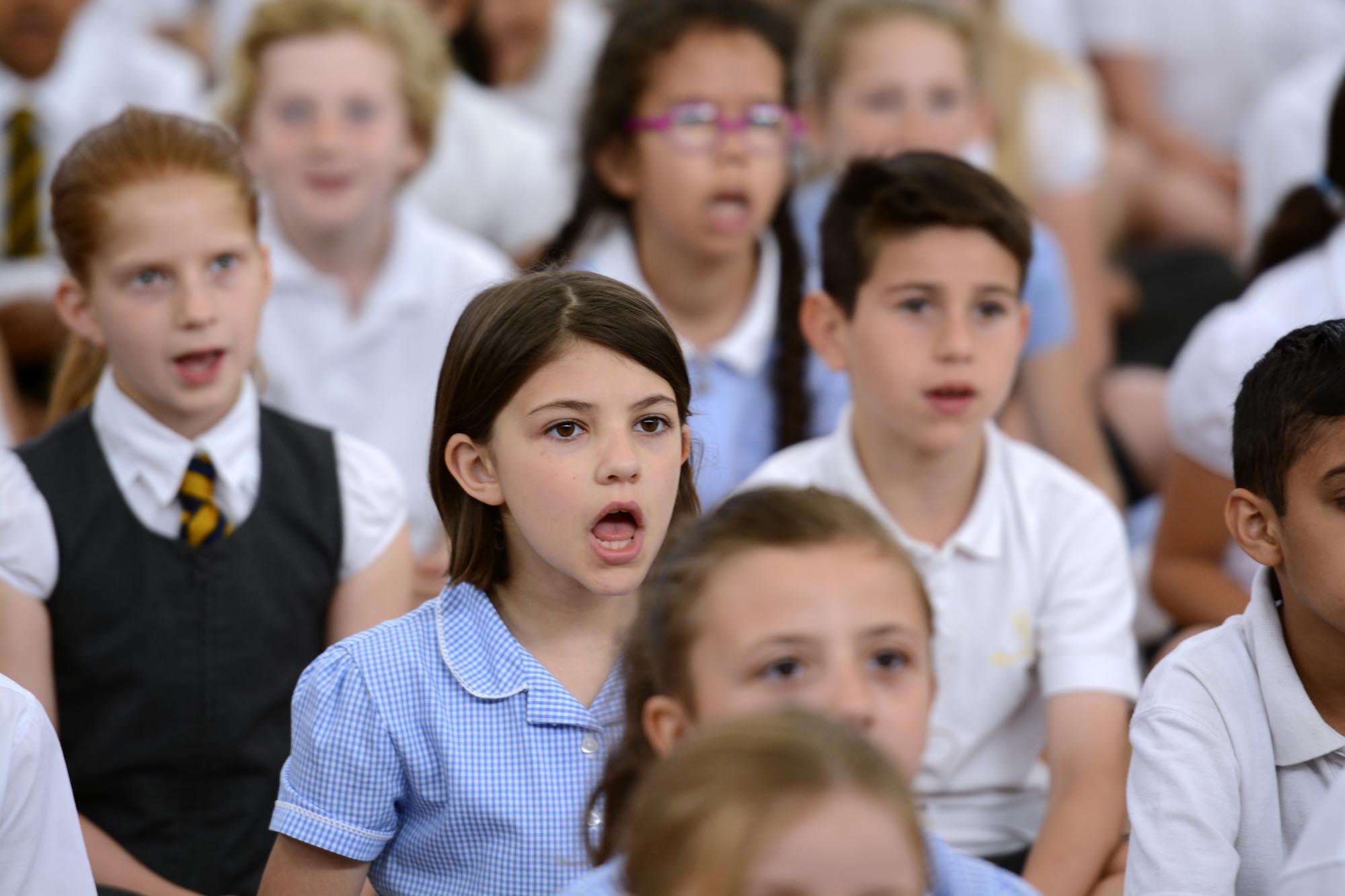 Girl in choir singing