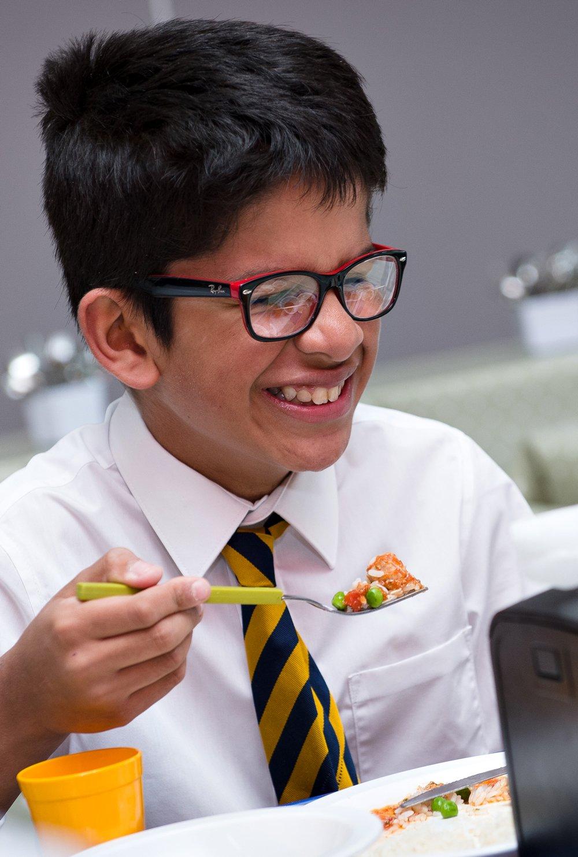 Boy eating healthy lunch