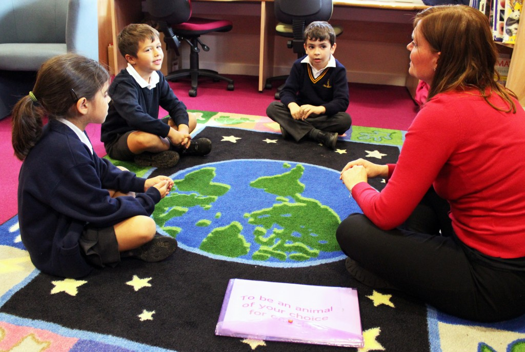 Children sitting in circle on the floor in the library