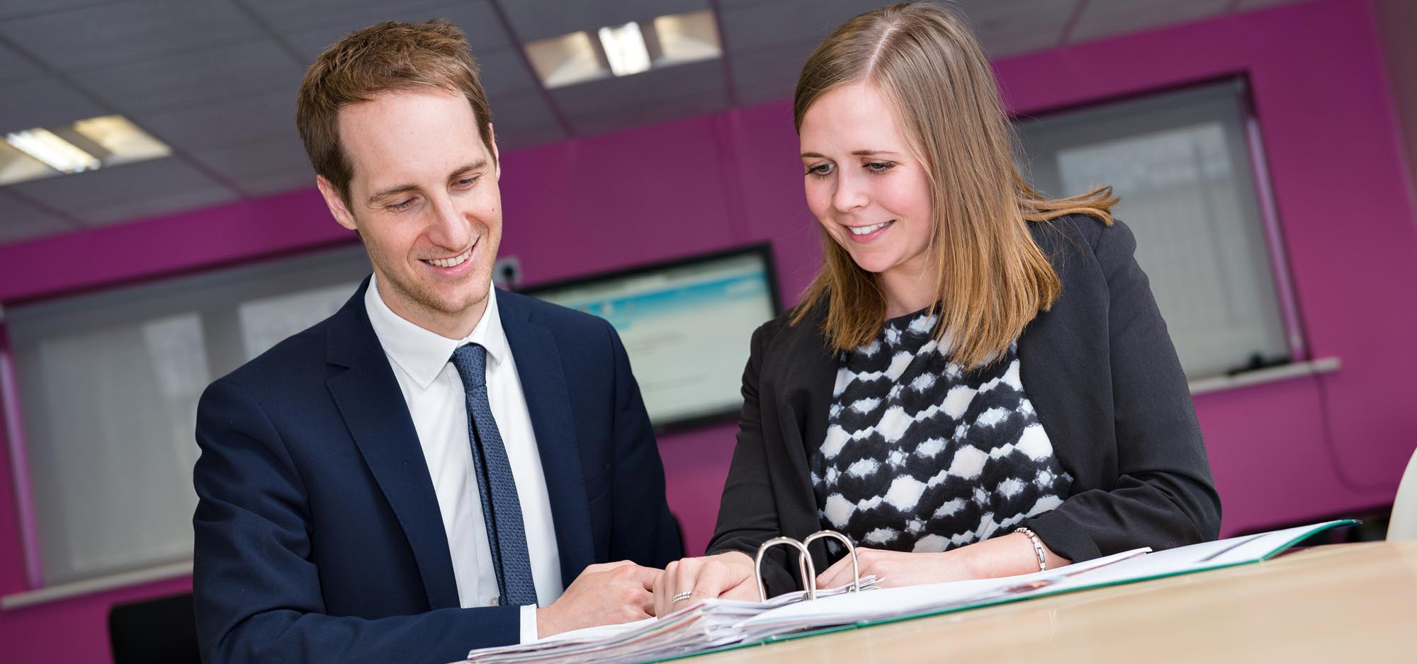 Mr Easter and Miss Edwards looking at documents