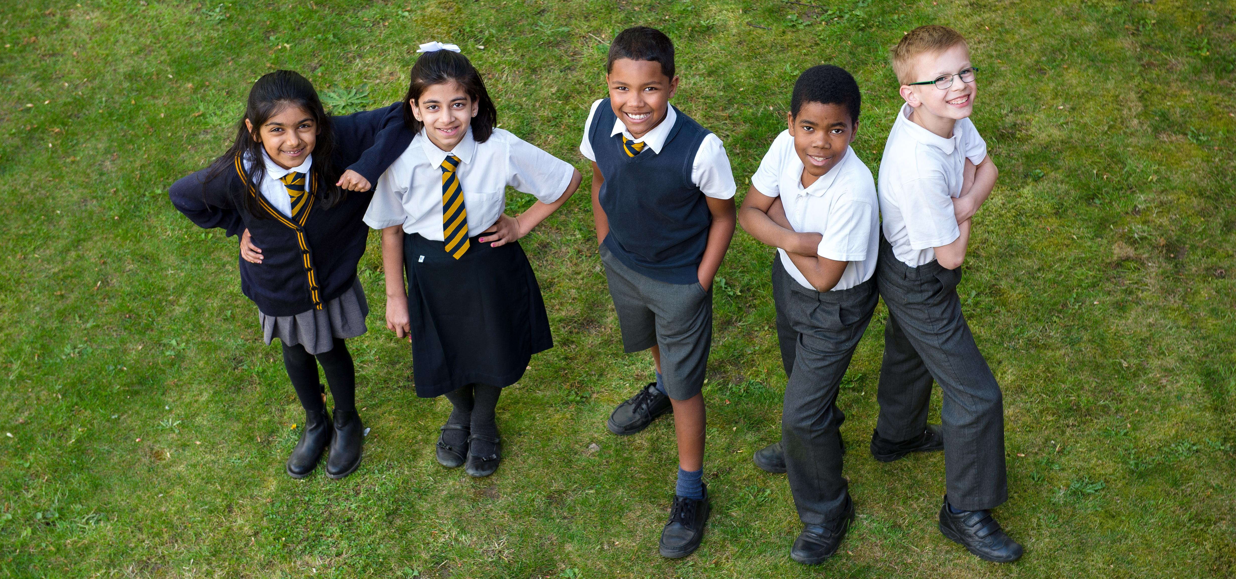 Five children in school uniform