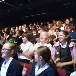 Children laughing and enjoying the performance